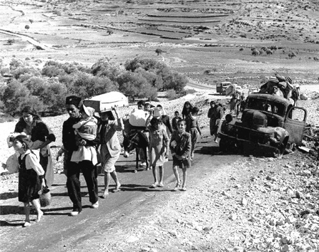 Palestinians driven from their homes in Galilee are on the road to Lebanon, November 1948.