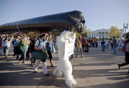 Protesters carry a replica of Keystone XL oil pipeline to protest increasing the amount of oil flow from tar sands, Alberta, Canada.