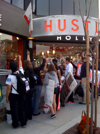 People flipping off Hustler in Los Angeles