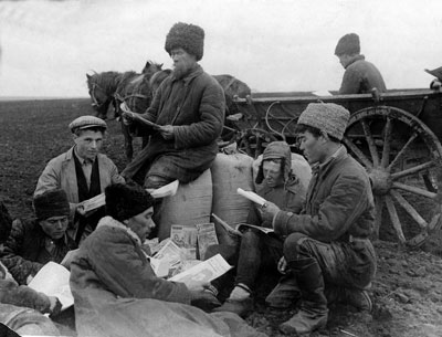 Peasants on a collective farm in the Soviet Union, 1930 read during a break. In a campaign to banish illiteracy among peasants the Soviet government sent millions of books, newspapers and magazines to villages across the country.