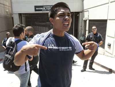 Los Angeles, August 2011. Protestor blocking an entrance to the United States Immigration Customs Enforcement (ICE) offices.