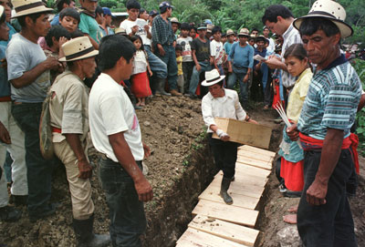 Mayan men bury victims of a 1982 massacre in a mass grave in Chel, a remote village  in northern Guatemala on July 4, 1998.