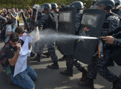 In Brasília, the capital city of Brazil, police shot pepper spray and tear gas to stop protesters from reaching Congress. In Rio de Janeiro, the police attacked protesters with tear gas and rubber bullets. Dozens were reported injured.