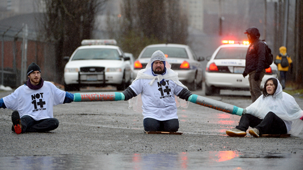Blocking the road in front of the federal Northwest Detention Center, Tacoma, Washington, February 2014. AP photo