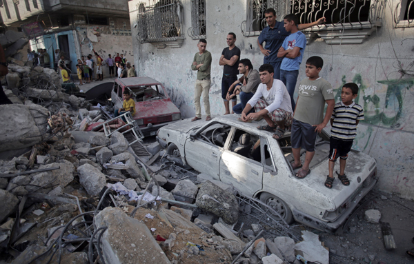 AP Photo: Rafah refugee camp in Gaza where five members of the Ghannam family were killed by an Israeli missile on July 11.