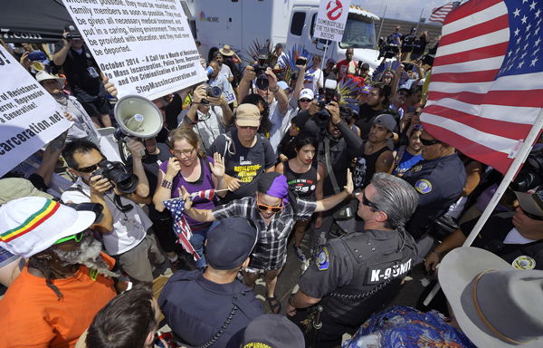 Supporters of immigrants rights face off with anti-immigrant forces in Murrieta, CA, July 4.