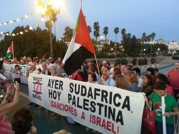 July 24, Seville, Andalusia (Spain) sign translates to: Yesterday South Africa, Today, Palestine. Sanctions against Israel!