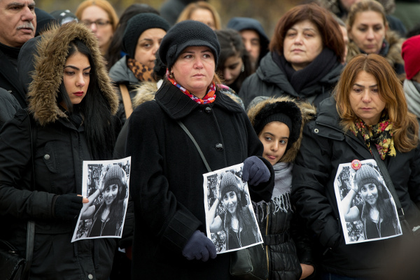 Demonstrators in Berlin hold photos of Tugce Albayrak, November 30, 2014