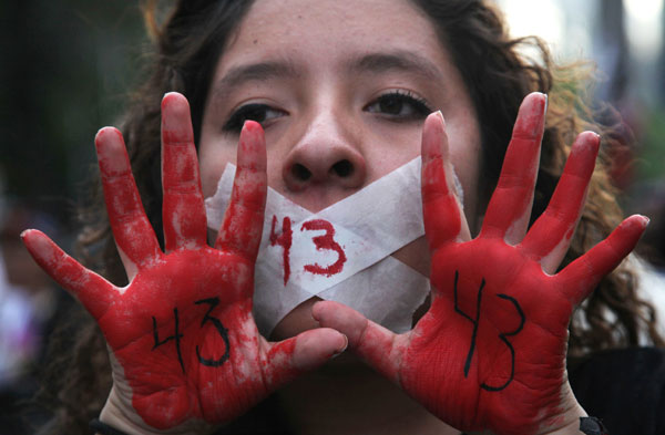 Protester holds up her red-painted hands and the number 43 written on them referring to the 43 missing students from the Isidro Burgos rural teachers college in Mexico City, December 26. Photo-AP