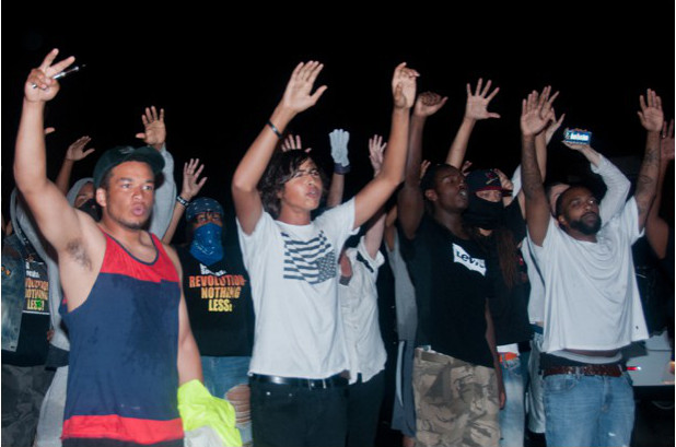 Ferguson, August 16, Saturday night, protesting curfew