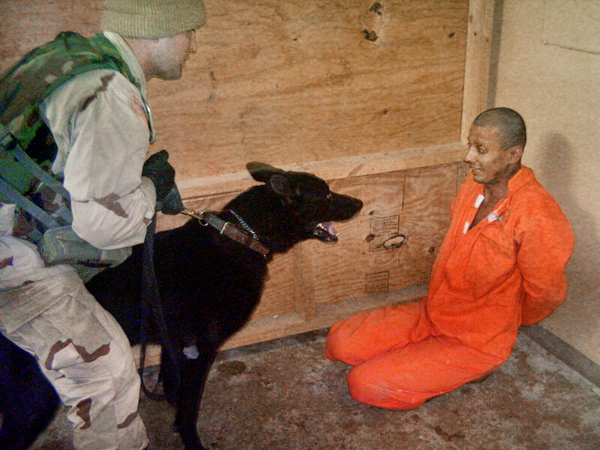 A prisoner being abused in Abu Ghraib prison.