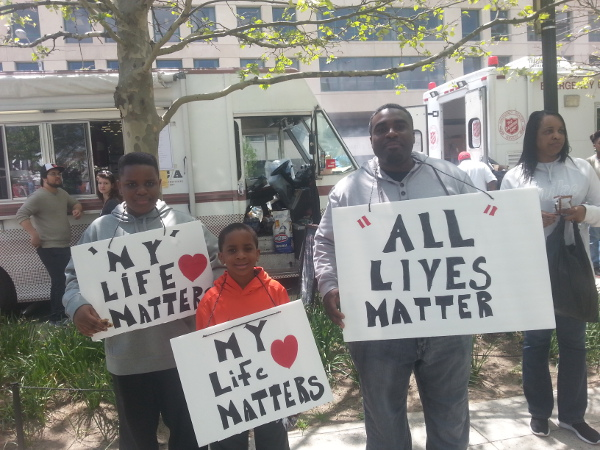 A man with his sons at the CIty Hall rally in Baltimore, May 2.