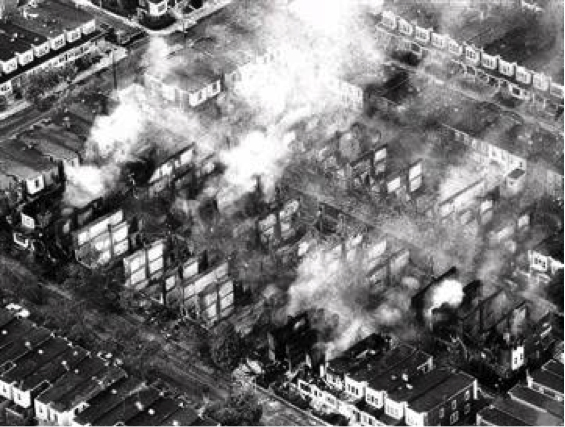 Osage Avenue burns after Philadelphia police dropped bomb on MOVE house. May 13, 1985.