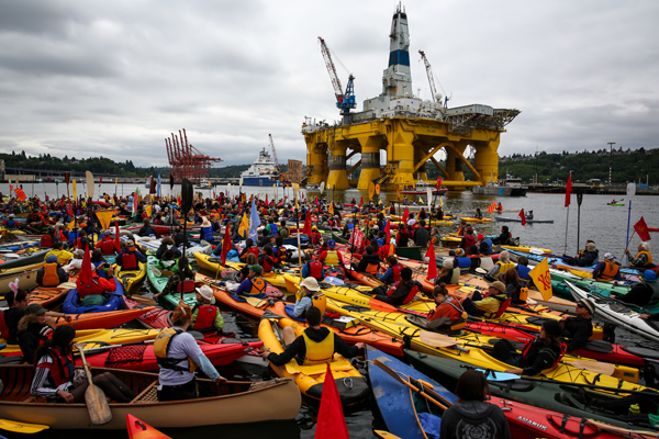 Hundreds of kayaktivists take to the water during a protest against drilling in the Arctic and the Port of Seattle being used as a port for the Shell Oil drilling rig Polar Pioneer, May 16, 2015, in Seattle. (AP photo)