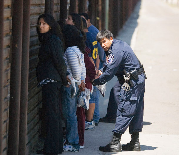 Immigrants detained and being prepared for deportation to Mexico