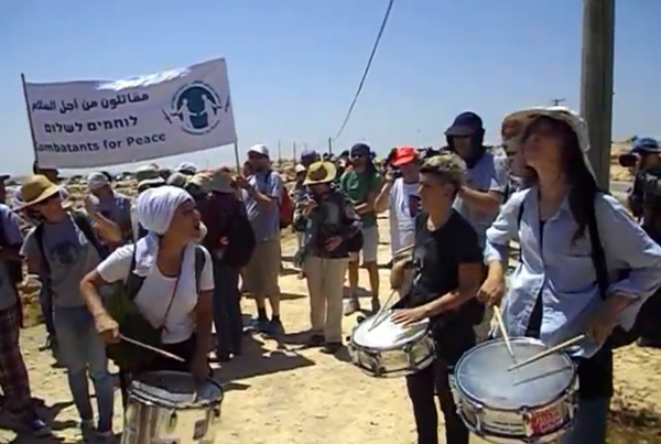 Israeli supporters of the Palestinian villagers in Susiya participate in the demonstration against the threatened Israeli demolition of the village.