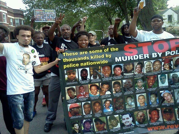 Joshua Lopez (left) with members of RiseUpOctober tour and people of Englewood community