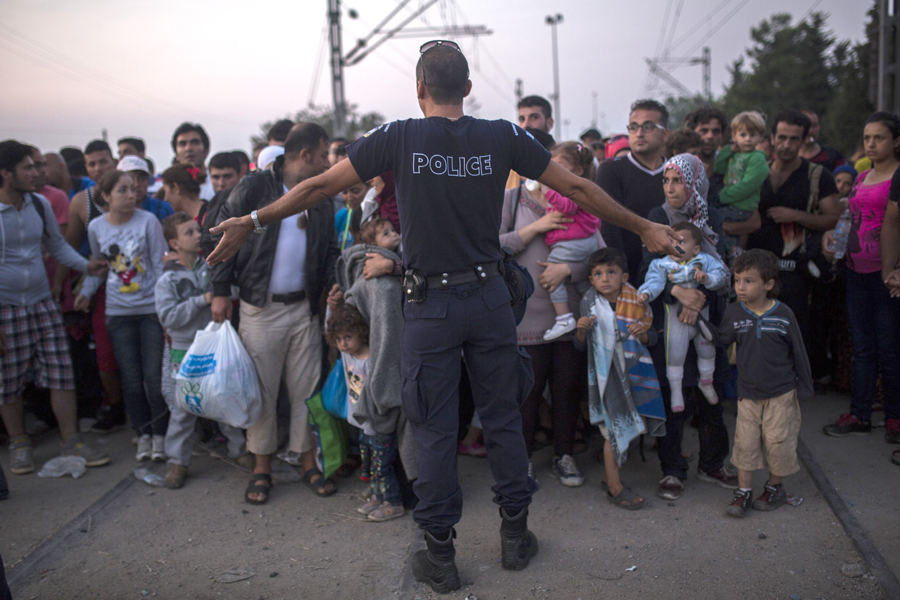 Syrian refugees as they wait to cross the border from Greece to Macedonia.  Aug. 26, 2015.