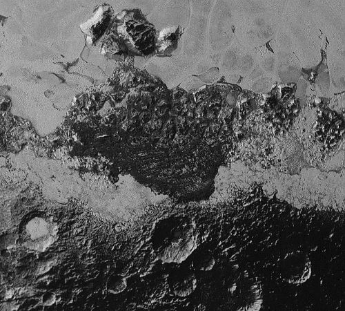 Dark features of Pluto