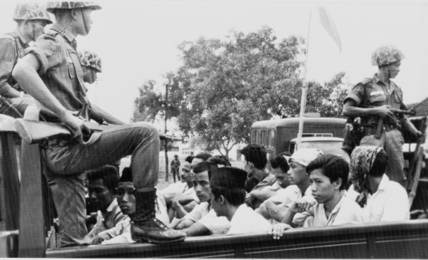 Members of the youth wing of the Indonesian Communist Party being hauled to a Jakarta prison, October 30, 1965.