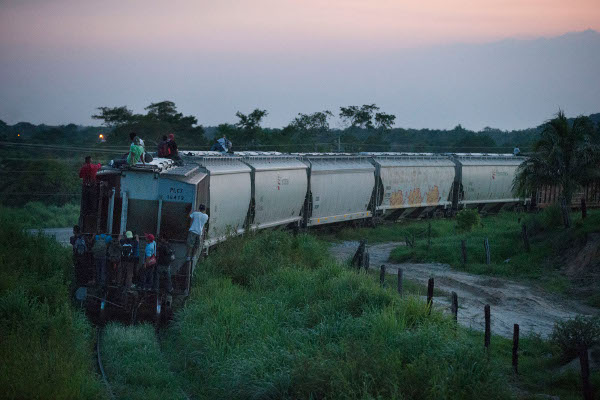 "Central American migrants riding ""La Bestia,"" a freight train that had provided a major route across Mexico prior to the crackdown, August 2014."