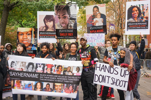 #SAYHERNAME contingent. The #SAYHERAME campaign documents women murdered by police.