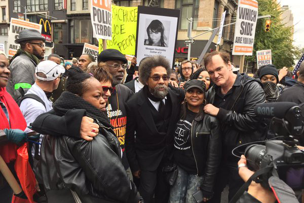 Eve Ensler, Carl Dix, Cornel West, Quentin Tarantino, on march with family members