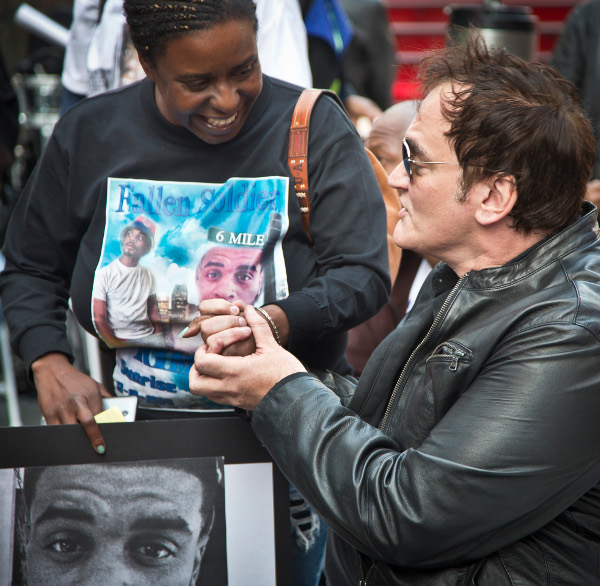 Quentin Tarantino meets Kimberly Griffin, whose son Kimoni Davis was killed by police, Times Square, October 22, at No More Stolen Lives: Say Their Names, A Public Reading and Remembrance--A Demand for Justice.