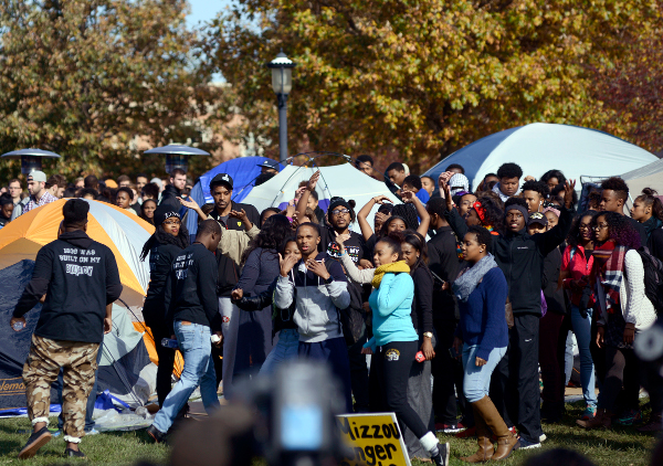 University of Missouri students celebrate as Jonathan Butler, center, waving, ended his hunger strike Monday, Nov. 9, 2015, after University of Missouri System President Tim Wolfe officially resigned.