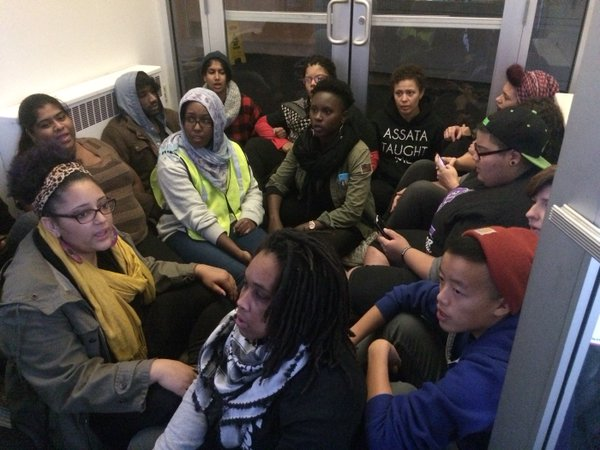 Occupying the Fourth District police station in Minneapolis, demanding the arrest of the police officer who shot Jamar Clark