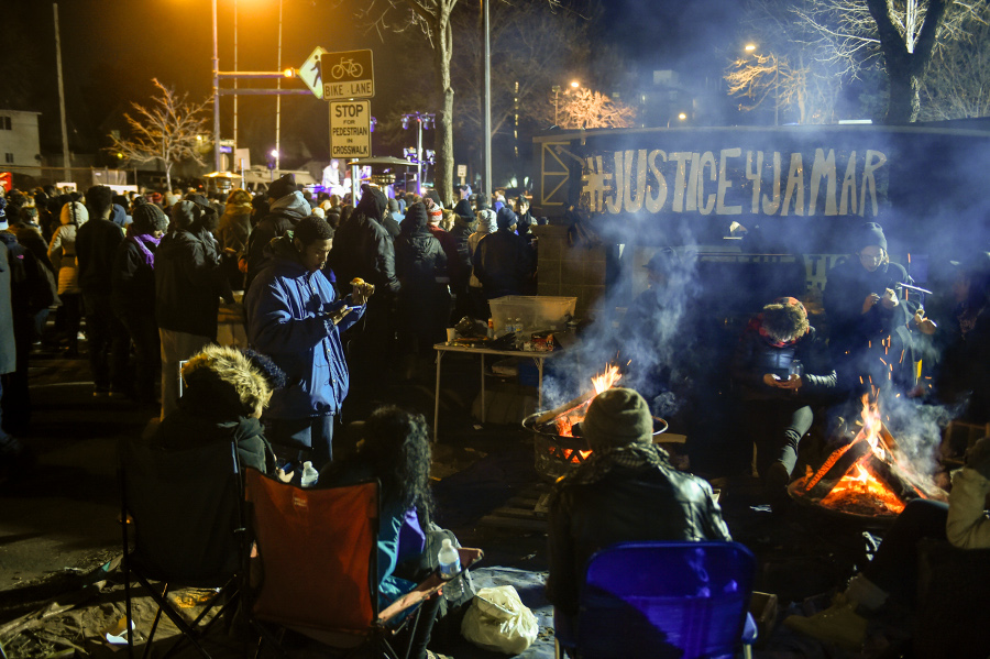 Demonstrators camp outside Minneapolis Police Department's 4th Precinct during a protest of the police murder of Jamar Clark, November 24. AP photo