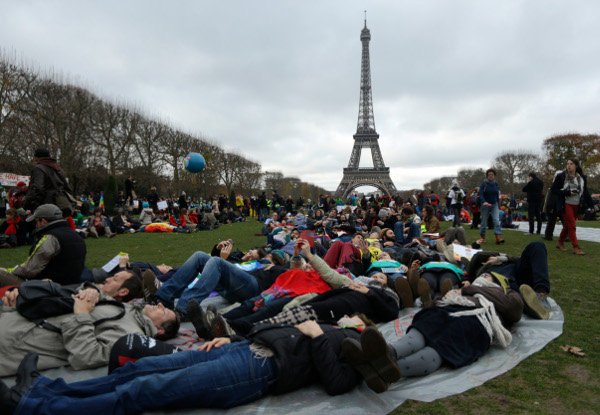 Die-in during protest near the Eiffel Tower, Paris, December 12.