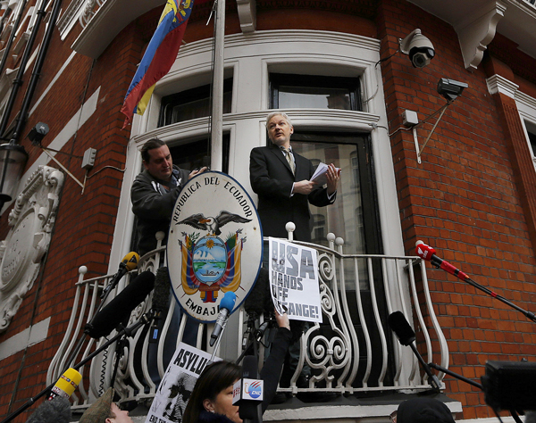 Julian Assange speaks to journalists and supporters from the balcony of the ecuadorian embassy in London, Friday, Feb. 5, 2016.