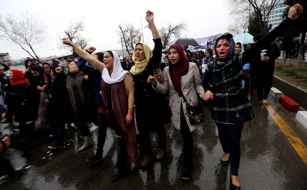 Afghan women protest the death of a woman who was beaten to death by a mob after being falsely accused of burning a Quran.