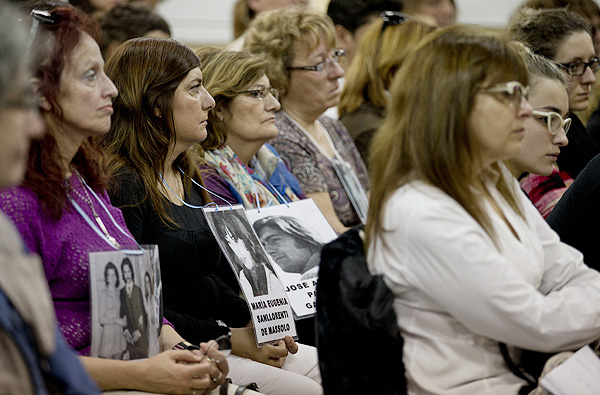 Women holding photos of disappeared relatives, Argentina