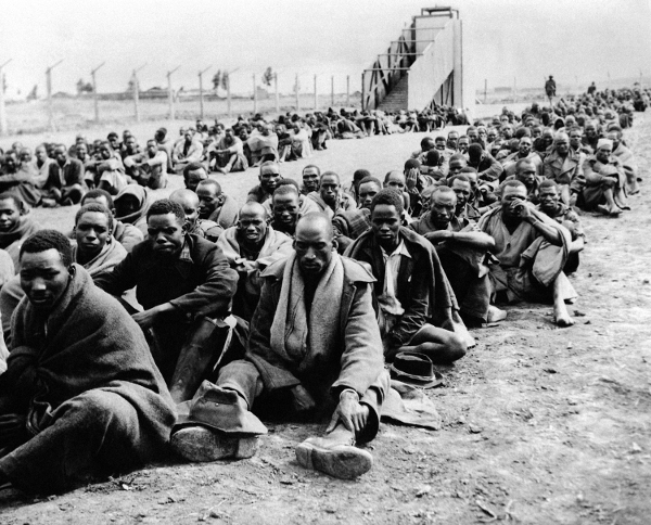 Some of the 150,000 Kikuyu people who were forced into detention camps in the Mau Mau rebellion, 1952.