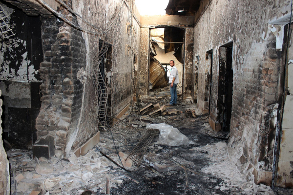 An employee of Doctors Without Borders stands inside the charred remains of their hospital after it was hit by a U.S. airstrike in Kunduz, Afghanistan, October 2015. AP photo