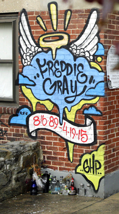 Mural at the spot where police  grabbed and arrested Freddie Gray.