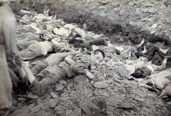 "This U.S. Army photograph, once classified ""top secret"", shows a moment during the summary execution of 1,800 South Korean political prisoners by the U.S.-backed South Korean military at Taejon, South Korea, over three days in July 1950."