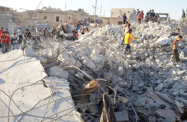 Buildings destroyed by U.S. airstrike in Kfar Derian, Syria, September 2014