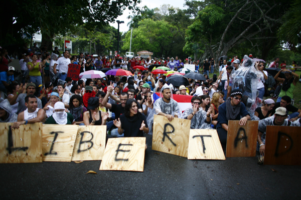 In 2010, students at the University of Puerto Rico blocked the main entrance to the Rio Piedras campus as part of a 2-day strike to protest budget cuts, a proposal to increase university fees and changes to the academic program.