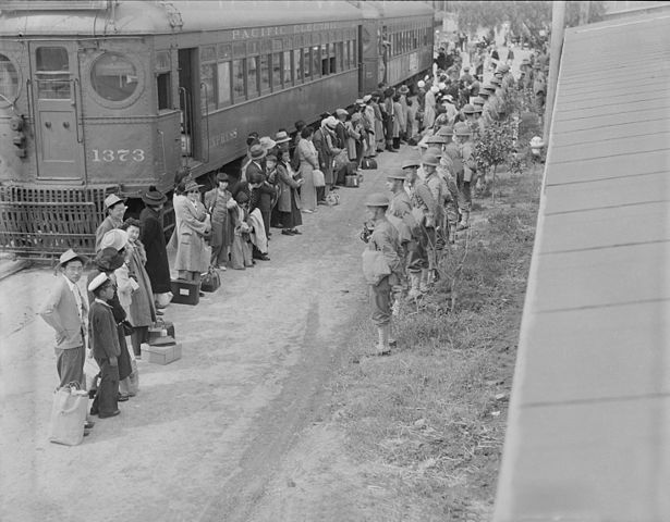 People of Japnese descent lined up at a train that will take them to the concentration camp at Gila River, Ariz., 1942.