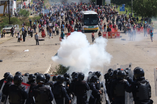 Protesting teachers face off against riot police on a federal highway  near the town of Nochixtlan, Mexico, June 19.