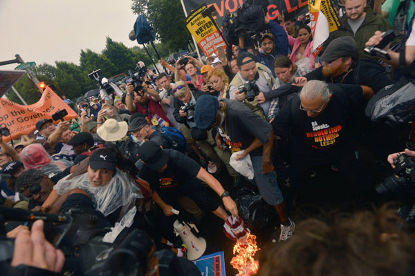 "American Flag Burns at DNC! Carl Dix, Joey Johnson, Revolution Club Declare: ""AMERICAN LIVES ARE NOT MORE IMPORTANT THAN OTHER PEOPLE'S LIVES"" Photo: Nicholas Isabella"