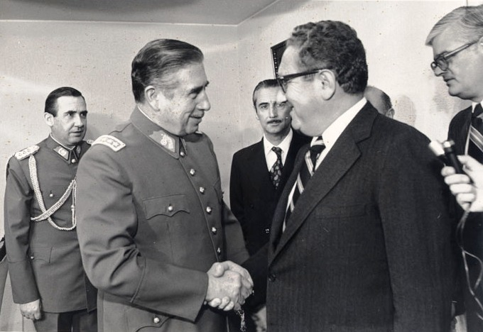 U.S. Secretary of State Henry Kissinger visits with Chilean dictator General Augusto Pinochet in 1976.