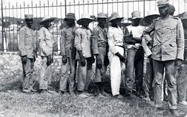 Haitian rebels are enslaved in ropes, 1915.