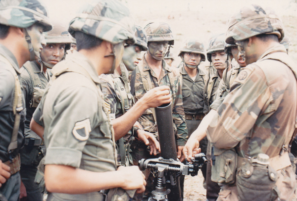 Honduran soldiers operate a mortar for members of the U.S. Army 82nd Airborne Division during a joint exercise, March 1988.
