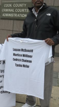 Holding t-shirt at Iggy and Alfredo's hearing
