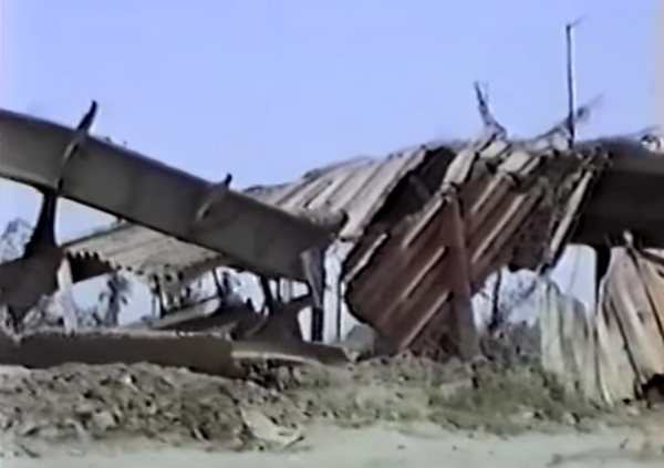 A bridge in Iraq after the U.S. attack. The 1991 U.S. bombing destroyed much of Iraq's water, sanitation, and electrical infrastructure.