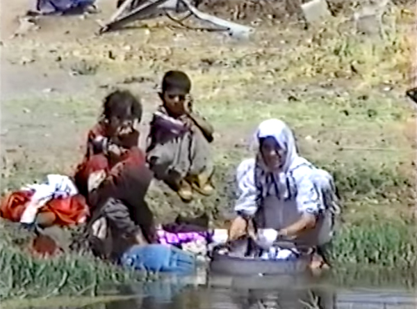 A family in Iraqi Kurdistan washing clothes in polluted water, 1991.